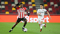 Ivan Toney of Brentford in action as Rotherham's Ryan Giles looks on during Brentford vs Rotherham United, Sky Bet EFL Championship Football at the Brentford Community Stadium on 27th April 2021