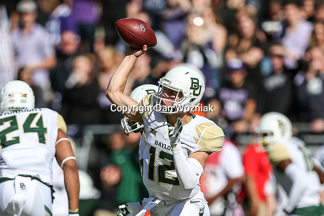 Baylor Bear quarterback Charlie Brewer (12) in action during the game between the Baylor Bears and the TCU Horned Frogs at the Amon G. Carter Stadium in Fort Worth, Texas.
