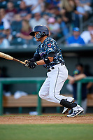 Jacksonville Jumbo Shrimp catcher Rodrigo Vigil (6) follows through on a swing during a game against the Mobile BayBears on April 14, 2018 at Baseball Grounds of Jacksonville in Jacksonville, Florida.  Mobile defeated Jacksonville 13-3.  (Mike Janes/Four Seam Images)