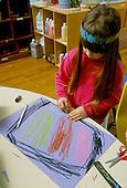 MR / Schenectady, New York.Yates Arts Magnet School - Pre-Kindergarten.Girl (4) does art (drawing) at free time..MR: Lyn1.PN#:29048                              FC#:20919-00213.scan from slide.© Ellen B. Senisi