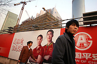 CHINA. Shanghai. Advertisements outside a construction site. Shanghai is a sprawling metropolis or 15 million people situated in south-east China. It is regarded as the country's showcase in development and modernity in modern China. This rapid development and modernization, never seen before on such a scale has however spawned countless environmental and social problems. 2008.