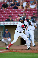 Cedar Rapids Kernels Yunior Severino (4) bats during a game against the Wisconsin Timber Rattlers on August 17, 2021 at Perfect Game Field in Cedar Rapids, Iowa.  (Mike Janes/Four Seam Images)