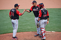 World Team manager Tony Perez (24) fist bumps pitcher Joe Jimenez (27) as catcher Elias Diaz (29) looks on during the MLB All-Star Futures Game on July 12, 2015 at Great American Ball Park in Cincinnati, Ohio.  (Mike Janes/Four Seam Images)