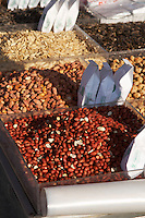 On a street market. Selling nuts, almonds, sunflower seeds and more. Thessaloniki, Macedonia, Greece
