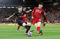 Atletico Madrid's Kieran Trippier is tackled by Liverpool's Andrew Robertson<br /> <br /> Photographer Rich Linley/CameraSport<br /> <br /> UEFA Champions League Round of 16 Second Leg - Liverpool v Atletico Madrid - Wednesday 11th March 2020 - Anfield - Liverpool<br />  <br /> World Copyright © 2020 CameraSport. All rights reserved. 43 Linden Ave. Countesthorpe. Leicester. England. LE8 5PG - Tel: +44 (0) 116 277 4147 - admin@camerasport.com - www.camerasport.com