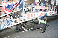 """Police help inflate a tire on the """"Trump Unity Bridge"""" before the Straight Pride Parade in Boston, Massachusetts, on Sat., August 31, 2019. The parade was organized in reaction to LGBTQ Pride month activities by an organization called Super Happy Fun America."""