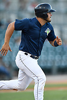 First baseman Brandon Brosher (25) of the Columbia Fireflies runs out a batted ball in a game against the Augusta GreenJackets on Sunday, July 30, 2017, at Spirit Communications Park in Columbia, South Carolina. Augusta won, 6-0. (Tom Priddy/Four Seam Images)