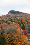 Indian Head Mountain as seen from the top of an observation platform some 40 feet above the ground in Lincon, New Hampshire in the White Mountains National Forest. Vertical during peak fall foliage colors.