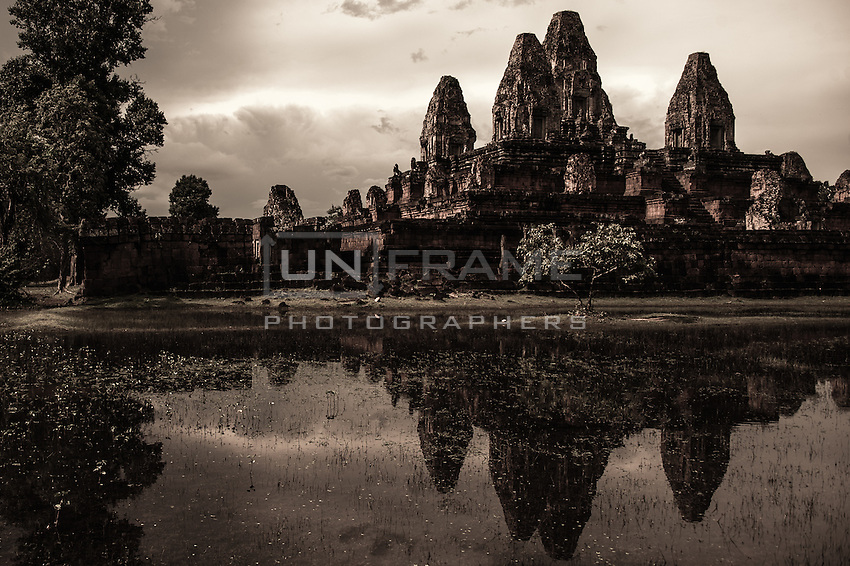 UNESCO World Heritage Site.  The center platform of the  Ankgor Wat temple  stands a so called quincunx of towers. The future of the monumental complex relies on a very delicate and complex balance between preservation and intensive tourist exploitation.   Seam Reap, Cambodia.