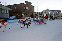 Thursday  March 15, 2007   ---- Nome, Alaska.  Rick Swenson beats Silvia Willis to the finish chute by only 6 seconds for 26th place.