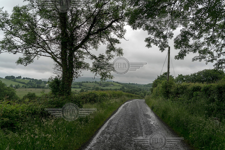 The border between the UK and the Republic of Ireland runs to the left of the road.