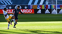 KANSAS CITY, KS - NOVEMBER 22: Marcos Lopez #27 of the San Jose Earthquakes and Jaylin Lindsey #26 of Sporting KC battle for the ball before a game between San Jose Earthquakes and Sporting Kansas City at Children's Mercy Park on November 22, 2020 in Kansas City, Kansas.