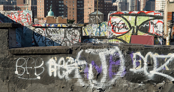 AVAILABLE FROM JEFF AS A FINE ART PRINT.<br /> <br /> AVAILABLE FROM JEFF FOR COMMERCIAL AND EDITORIAL LICENSING.<br />  <br /> Graffiti on Tenement Rooftops in Lower Manhattan, New York City, New York State, USA