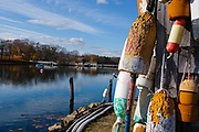 Buoys hang from a shed at the John Hancock Wharf in York, Maine.