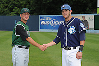 Augusta Green Jackets Brett Bochy (son of Bruce Bochy Manager of the San Francisco Giants) and Asheville Tourists Mark Tracy (son of Jim Tracy Manager of the Colorado Rockies) meet on the field before a game  between the two teams at McCormick Field onJuly 9, 2011 in Asheville, North Carolina.    (Tony Farlow/Four Seam Images)