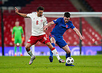 Declan Rice (West Ham United) of England holds off Thomas Delaney (Borussia Dortmund) of Denmark during the UEFA Nations League match played behind closed doors due to the current government Covid-19 rules within sports venues between England and Denmark at Wembley Stadium, London, England on 14 October 2020. Photo by Andy Rowland.