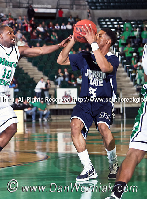 Jackson State Tigers guard Rod Melvin (3) drives in for a basket in the game between the Jackson State Tigers and the University of North Texas Mean Green at the North Texas Coliseum,the Super Pit, in Denton, Texas. UNT defeated Jackson 68 to 49