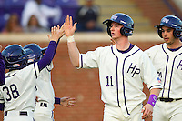 Spencer Angelis (11) of the High Point Panthers after scoring a run against the Liberty Flames at Willard Stadium on March 23, 2013 in High Point, North Carolina.  The Panthers defeated the Flames 9-3.  (Brian Westerholt/Four Seam Images)