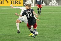 FOXBOROUGH, MA - NOVEMBER 1: Alexander Buttner #28 of New England Revolution passes the ball as Yamil Asad #11 of DC United comes in to tackle during a game between D.C. United and New England Revolution at Gillette Stadium on November 1, 2020 in Foxborough, Massachusetts.