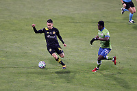 COLUMBUS, OH - DECEMBER 12: Lucas Zelarayan #10 of the Columbus Crew is defended by Yeimar Gomez Andrade #28 of the Seattle Sounders FC during a game between Seattle Sounders FC and Columbus Crew at MAPFRE Stadium on December 12, 2020 in Columbus, Ohio.