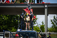 """MADRID, SPAIN – JUNE 21: Police arrest activist as People protest in front of the research center of the oil company Repsol on June 21 in Madrid, Spain. Activists from XR (Extinction Rebellion) and other environmental associations such as """"amigos por la tierra"""" and greenpeace have blocked the entrance to the Repsol research center in Móstoles, calling for the cessation of their fossil activities as a measure to climate change. (Photo by Joan Amengual/VIEWpress)"""