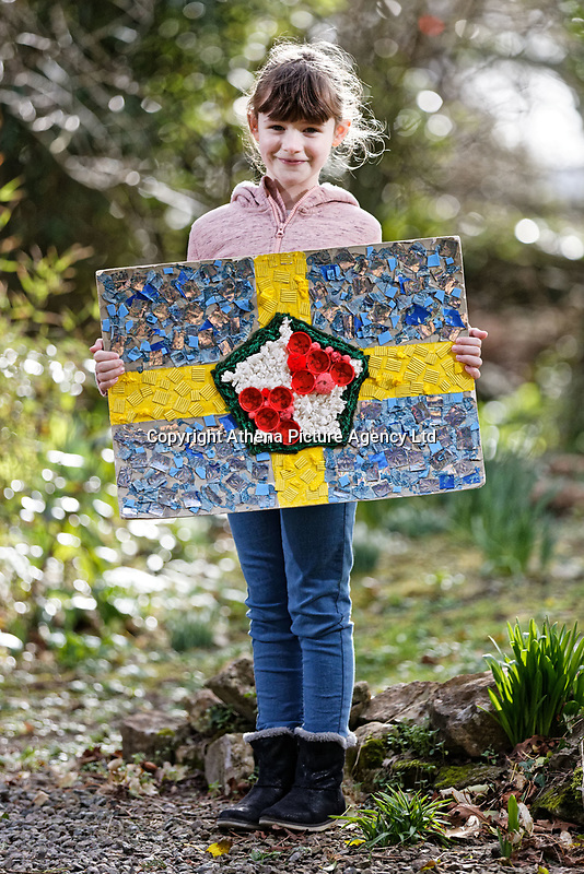 Pictured: Elly Neville with the flag she created at her home in Pembroke, west Wales, UK. Tuesday 20 February 2018<br /> Re: Seven-year-old Elly Neville who was born despite doctors saying her parents would not be able to have any more children, has raised over £150,000 for the cancer ward that treated her father.<br /> Her parents Lyn and Ann had been told they were unlikely to have more children after he underwent a bone marrow transplant in 2005. <br /> Mr Neville subsequently spent a lot of time on the Ward 10 cancer facility at Withybush Hospital in Haverfordwest, Pembrokeshire.<br /> But four years later they were stunned when his painter and decorator wife Ann fell pregnant again.