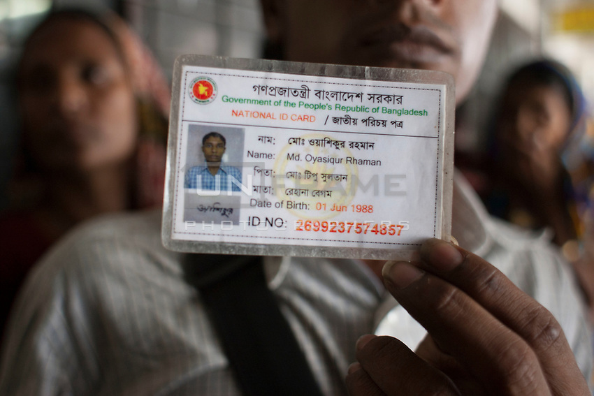 A Bangladeshi man holds the National ID card of Oyasiqur Rahman Babu, which is recovered from his body. Bangladeshi blogger Oyasiqur Rahman Babu hacked to death today around 9:45am at the Tejgaon Indsutrial area in Dhaka, Bangladesh, March 30, 2015. Two madrasa students have been detained with sharp weapons for suspected involvement with the murder. Three meat cleavers have been recovered from the spot. This assassination follows a similar murder of blogger-writer Avijit Roy on Feb 25 at the Dhaka University campus. The two arrested for suspected involvement are  'Zikrullah', a Chittagong madrassa student ,  and Arif', a student of  a madrasa in Dhaka's Mirpur area, according to police.