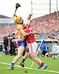 Cian Dillon of Clare in action against Patrick Horgan of Cork during their Munster senior hurling final at Thurles. Photograph by John Kelly.