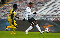2nd January 2021; Liberty Stadium, Swansea, Glamorgan, Wales; English Football League Championship Football, Swansea City versus Watford; Marc Guehi of Swansea City passes the ball while under pressure from Ismaila Sarr of Watford