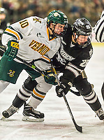 29 December 2014: University of Vermont Catamount Forward Travis Blanleil, a Freshman from Kelowna, British Columbia takes a first period face-off against Providence College Friar Forward Robbie Hennessey, a Freshman from Garnet Valley, PA, during the deciding game of the annual TD Bank-Sheraton Catamount Cup Tournament at Gutterson Fieldhouse in Burlington, Vermont. The Friars shut out the Catamounts 3-0 to win the 2014 Cup. Mandatory Credit: Ed Wolfstein Photo *** RAW (NEF) Image File Available ***