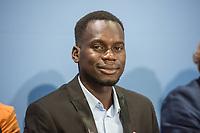 """Pressekonferenz des Kindernothilfe e.V. zum """"Red Hand Day 2019"""".<br /> In der Pressekonferenz berichteten Vertreter von terre des hommes, der Kindernothilfe, dem deutschen Buendnis Kindersoldaten, Child Soldiers International und der ehemalige ugandischer Kindersoldat Innocent Opwonya (im Bild) ueber die Kampagne """"Straight 18 - weltweit gegen die Rekrutierung von Kindern und Jugendlichen als Soldaten"""", ueber die Situation und den Schutz von Kindern im Krieg und die deutsche Verantwortung und was es bedeutet, als Kind mit der Waffe kaempfen zu muessen.<br /> 11.2.2019, Berlin<br /> Copyright: Christian-Ditsch.de<br /> [Inhaltsveraendernde Manipulation des Fotos nur nach ausdruecklicher Genehmigung des Fotografen. Vereinbarungen ueber Abtretung von Persoenlichkeitsrechten/Model Release der abgebildeten Person/Personen liegen nicht vor. NO MODEL RELEASE! Nur fuer Redaktionelle Zwecke. Don't publish without copyright Christian-Ditsch.de, Veroeffentlichung nur mit Fotografennennung, sowie gegen Honorar, MwSt. und Beleg. Konto: I N G - D i B a, IBAN DE58500105175400192269, BIC INGDDEFFXXX, Kontakt: post@christian-ditsch.de<br /> Bei der Bearbeitung der Dateiinformationen darf die Urheberkennzeichnung in den EXIF- und  IPTC-Daten nicht entfernt werden, diese sind in digitalen Medien nach §95c UrhG rechtlich geschuetzt. Der Urhebervermerk wird gemaess §13 UrhG verlangt.]"""