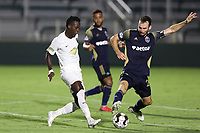 CARY, NC - AUGUST 01: Rudolf Mensah #14 shoots the ball past Conor Donovan #20 during a game between Birmingham Legion FC and North Carolina FC at Sahlen's Stadium at WakeMed Soccer Park on August 01, 2020 in Cary, North Carolina.