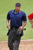 July 10, 2009:  Home plate umpire Chris Gonzalez during a game at Bright House Networks Field in Clearwater, FL.  Photo By Mike Janes/Four Seam Images