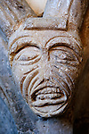 Pre Reformation carved stone corbel  of a grimacing face at St Mary The Virgin church, St Mary in the Marsh, Romney Marsh, Kent. UK