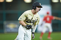 Ethan Paul (10) of the Vanderbilt Commodores hustles towards home plate against the Houston Cougars during game nine of the 2018 Shriners Hospitals for Children College Classic at Minute Maid Park on March 3, 2018 in Houston, Texas. The Commodores defeated the Cougars 9-4. (Brian Westerholt/Four Seam Images)