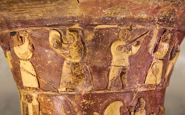Hüseyindede vases, Old Hittite Polychrome Relief vessel, top frieze depicting a procession of musicians and dancers, , 16th century BC. . Çorum Archaeological Museum, Corum, Turkey. Against a warm art bacground.