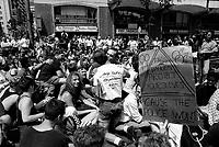 Sit in pacifique devant le poste 25 suite au raid policier du SEX GARAGE , le 16 juillet 1990. <br /> Le raid du SEX GARAGE aussi connu comme le Stonewall montrealais est un moment charnier de l'histoire gai de Montreal.<br /> <br /> PHOTO : Pierre Roussel -  Agence Quebec Presse