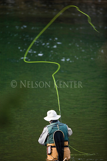 A fly fisherman on the Blackfoot River in western Montana above Missoula