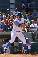 Adam Milligan #25  of the Myrtle Beach Pelicans hitting in a game against the Wilmington Blue Rocks on April 11, 2010  in Myrtle Beach, SC.