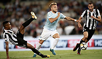 Calcio, Football - Juventus vs Lazio Italian Super Cup Final  <br /> Lazio's Ciro Immobile (c) in action with Juventu's Giorgio Chiellini (r) and Alex Sandro (l) during the Italian Super Cup Final football match between Juventus and Lazio at Rome's Olympic stadium, on August 13, 2017.<br /> UPDATE IMAGES PRESS/Isabella Bonotto