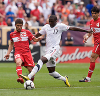Jozy Altidore (17) of the USMNT takes the ball away from Sabri Sariogulu (25) of Turkey at Lincoln Financial Field in Philadelphia, PA.  The USMNT defeated Turkey, 2-1.