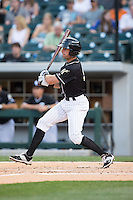 Drew Garcia (2) of the Charlotte Knights follows through on his swing against the Louisville Bats at BB&T BallPark on May 12, 2015 in Charlotte, North Carolina.  The Knights defeated the Bats 4-0.  (Brian Westerholt/Four Seam Images)
