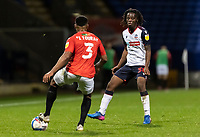 Bolton Wanderers' Peter Kioso challenging Salford City's Ibou Touray (left) <br /> <br /> Photographer Andrew Kearns/CameraSport<br /> <br /> The EFL Sky Bet League Two - Bolton Wanderers v Salford City - Friday 13th November 2020 - University of Bolton Stadium - Bolton<br /> <br /> World Copyright © 2020 CameraSport. All rights reserved. 43 Linden Ave. Countesthorpe. Leicester. England. LE8 5PG - Tel: +44 (0) 116 277 4147 - admin@camerasport.com - www.camerasport.com