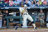 Michigan Wolverines outfielder Jordan Brewer (22) swings the bat against the Vanderbilt Commodores during Game 1 of the NCAA College World Series Finals on June 24, 2019 at TD Ameritrade Park in Omaha, Nebraska. Michigan defeated Vanderbilt 7-4. (Andrew Woolley/Four Seam Images)