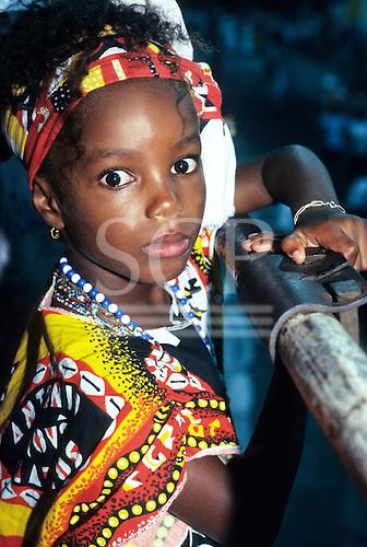 Salvador, Bahia, Brazil. Young African Brazilian girl in carnival costume of Ilê Ayê block.