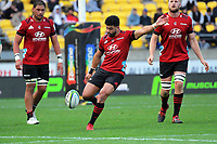 Richie Mo'unga clears for touch during the Super Rugby Aotearoa match between the Hurricanes and Crusaders at Sky Stadium in Wellington, New Zealand on Saturday, 21 June 2020. Photo: Dave Lintott / lintottphoto.co.nz