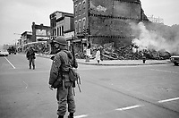 Washington (DC) USA - April 1968 - <br /> Photograph showing a soldier standing guard in a Washington, D.C., street with the ruins of buildings that were destroyed during the riots that followed the assassination of Martin Luther King, Jr.