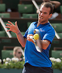 May 25,2016:   Adrian Mannarino (FRA) loses to Milos Raonic (CAN) 6-1, 7-6, 6-1, at the Roland Garros being played at Stade Roland Garros in Paris, .  ©Leslie Billman/Tennisclix/CSM