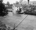 Oakville's Riverside Street brought back memories of the flood of 1955, as waters spilled into the lower floorsof the Bowman A. Burke home July 21, 1963.