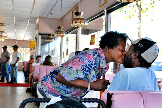 0552: homeless African-Americans: Katherine Menefield, 57,  (916) 929-1416, gives her boyfriend, Floyd Thomas, 51, a kiss during breakfast at Lil Joe's, 1701 Del Paso. Blvd. in North Sacramento. (photo by Pico van Houtryve)